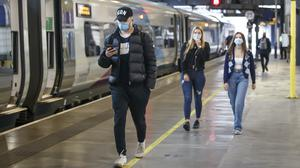 Passengers wearing face masks at Leeds railway station as face coverings became mandatory on public transport in England (Danny Lawson/PA)