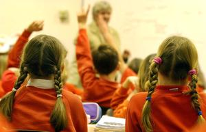 Larne Grammar School is reducing class time due to budget cuts. (PA)