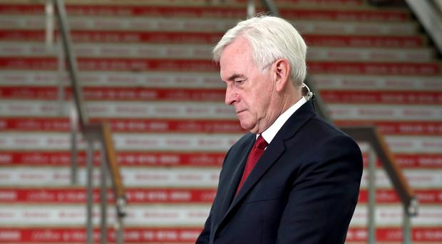 Shadow Chancellor John McDonnell takes part in morning media interviews during the Labour Party Conference in Brighton (PA)