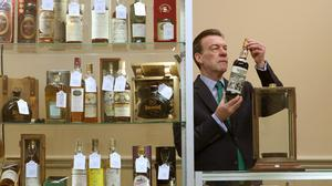 The 60-year-old Macallan has a label designed by Sir Peter Blake (Andrew Milligan/PA)