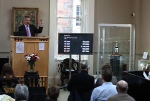 Auctioneer Charles Graham-Campbell during the auction for the 60-year-old Macallan (Andrew Milligan/PA)