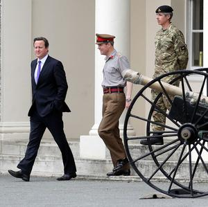 Prime Minister David Cameron leaves Woolwich Barracks in London (PA)