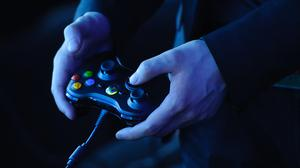 A man holds an Xbox 360 controller at a preview event for Star Trek: the Video Game, at the Science Museum, in central Lodnon.
