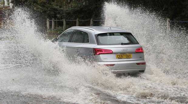 Nearly three-quarters of motorists would risk driving through flood water, a poll has found (Owen Humphreys/PA)