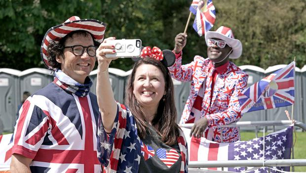 US support: Alex and Melisa Sirek from Orlando with Joshua Arane from Battersea on the Long walk in Windsor (Owen Humphreys/PA)