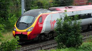 Virgin Group has submitted a range of recommendations to change the way long-distance rail services are run (Rui Vieira/PA)