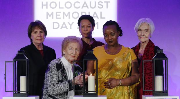 Actors (back row left to right) Dame Penelope Wilton, Nina Sosanya and Sheila Hancock join Holocaust survivor Mindu Hornick (front left) and Rwandan genocide survivor Chantal Uwamahoro (front right) in lighting a candle in memory of all victims of genocide at a Holocaust Memorial Day ceremony at the QEII Centre in London (Jonathan Brady/PA)