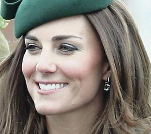 Catherine, Duchess of Cambridge laughs as she attends the St Patrick's Day parade at Mons Barracks on Monday