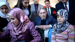 Foreign Secretary Philip Hammond meets children taking lessons during a visit to the Saricam refugee camp near Adana in Turkey, which provides aid to approximately 10,800 Syrians who have fled the civil war