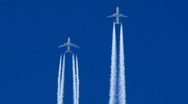 The Green Party plans would ban ads for flights (Peter Byrne/PA)