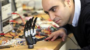 Dr Kianoush Nazarpour from the university's Biomedical Engineering department with a new bionic hand
