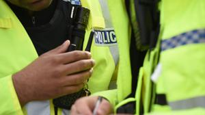 A man has been arrested after a police officer was injured while responding to reports about a burglary