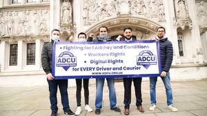 Uber drivers with Yaseen Aslam (second right) outside the Supreme Court in London (Ian West/PA)