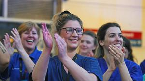 Staff from the Chelsea and Westminster Hospital in London join the salute to local heroes during Thursday's nationwide Clap for Carers NHS initiative to applaud NHS workers fighting the coronavirus pandemic (PA)