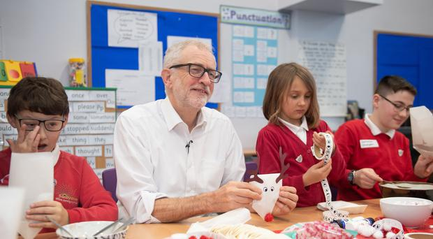 Labour leader Jeremy Corbyn making reindeer hot chocolate pouches with pupils in Morecambe (Joe Giddens/PA)