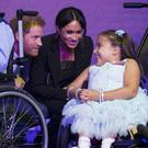 The Duke and Duchess of Sussex meet seven-year-old Matilda Booth during the annual WellChild Awards (PA)