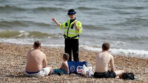 Police have been told they have no powers to enforce two-metre social distancing in England (Gareth Fuller/PA)