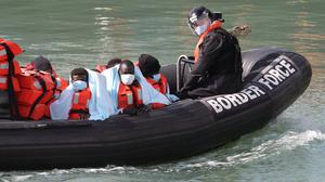 A group of people thought to be migrants are brought into Dover, Kent, by Border Force officers (Gareth Fuller/PA)