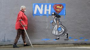 An artist has painted pub murals in tribute to NHS workers (Danny Lawson/PA)