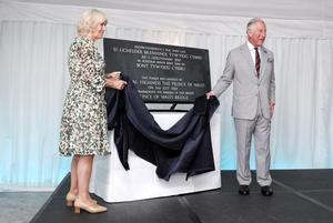 The Prince of Wales and the Duchess of Cornwall unveiling a plaque to mark the naming of the Prince of Wales Bridge (Wales Office/PA)