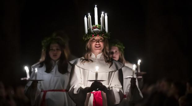 The Chorus Pictor and Friends helps celebrate the Sankta Lucia service at York Minster – a Scandinavian festival of light (Danny Lawson/PA)