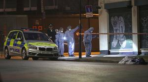 Forensic officers and police at the scene in Stoke Newington (Yui Mok/PA)