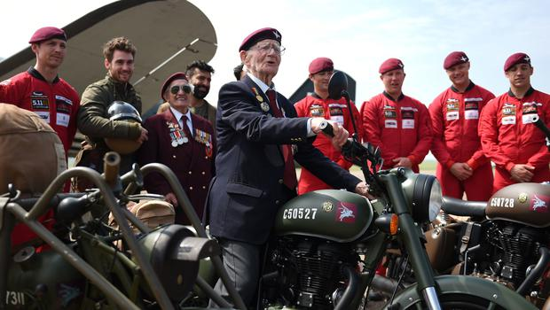 Fred Glover, 92, who served in the parachute regiment during the Second World War, with the new motorcycle (Joe Giddens/PA)