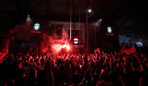 Flares were lit outside Anfield (Peter Byrne/PA)