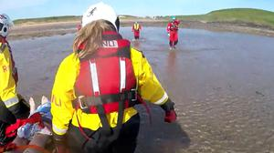 A woman has been rescued after she fell 20 feet down a cliff (RNLI/PA)