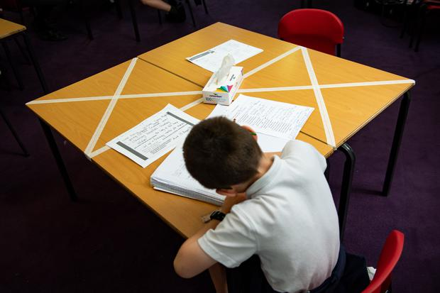 Social-distancing measures as a child studies on a marked table at Kempsey Primary School in Worcester. Nursery and primary pupils could return to classes from June 1 following the announcement of plans for a phased reopening of schools (Jacob King/PA)