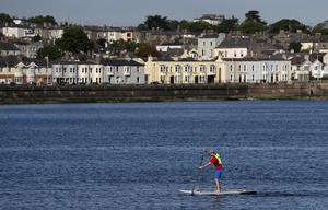 A man paddleboards in Dublin Bay as the sun shines (Brian Lawless/PA)