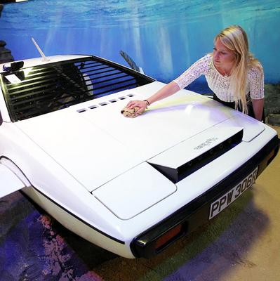 RM Auctions assistant Hannah Fairclough with the James Bond submarine car, used in the Spy Who Loved Me