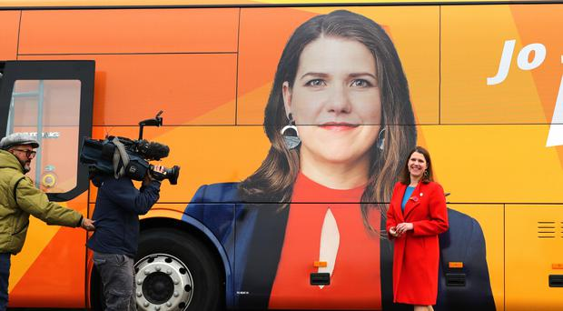 Liberal Democrat leader Jo Swinson in front of the party battle bus (Aaorn Chown/PA)