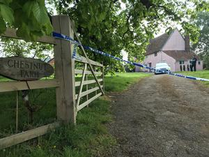 Police officers at the scene outside a farmhouse in Barham in Suffolk, where Silke Hartshorne-Jones was found with gunshot wounds. (Sam Russell/ PA)