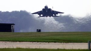 An F15 fighter takes off from RAF Lakenheath in Suffolk (Andrew Parsons/PA)