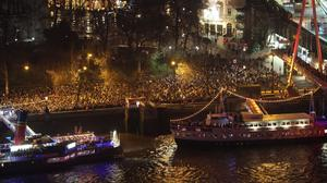 Crowds gather on the Victoria Embankment in central London as they wait to usher in the the New Year and watch the firework celebrations