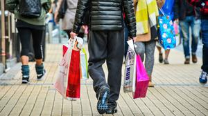 Retailers experienced slowing sales last month as households reined in their spending amid mounting pressure on their finances (Ben Birchall/PA)