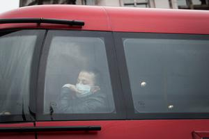 Passengers wear protective masks on buses in London (Sterfan Rousseau/PA)