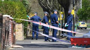 Police officers search Chestnut Avenue in Forest Gate, east London, where 18-year-old Sami Sidhom was fatally stabbed (Stefan Rousseau/PA)