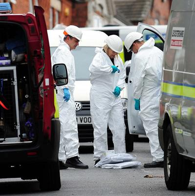 Forensic officers at the scene of a house fire in Wood Hill, Leicester
