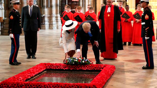 Mr Trump lays a wreath in Westminster Abbey, as Ivanka Trump looks