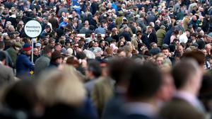 Crowds during day four of the Cheltenham Festival at Cheltenham Racecourse.
