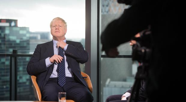 Prime Minister Boris Johnson prepares to appear on the BBC's Andrew Marr show at Media City in Salford before opening the Conservative party annual conference at the Manchester Convention Centre.