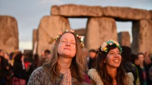 People gather at Stonehenge in Wiltshire to see in the new dawn during this year's Summer Solstice