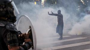 Police have used tear gas and rubber bullets against protesters angry about the death of George Floyd. (Ben Gray/PA)