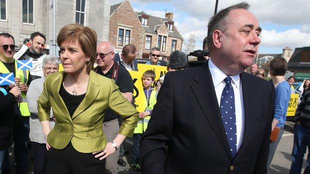 Scotland's First Minister Nicola Sturgeon with Alex Salmond (Andrew Milligan/PA)