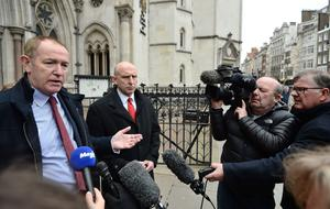 Sir Kevin Barron and John Healey speak to the media outside the Royal Courts of Justice in central London (John Stillwell/PA)