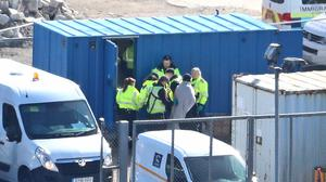 A man being escorted to a van by Border Force officers in Dover, Kent (Gareth Fuller/PA)