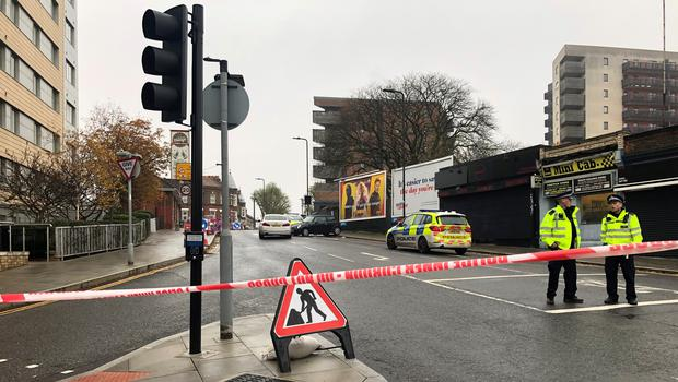 The scene outside West Ealing railway station where a man died after being stabbed before crashing his vehicle into another car in west London (PA)