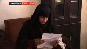 Photo issued by ITV News of Shamima Begum, 19, in a Syrian refugee camp, being shown a copy of the Home Office letter which stripped her of her British citizenship (ITV News/PA)